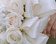 The bride carried five dozen ivory roses with pearl centered stephanotis that accented the pearls in her gown.