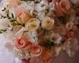 This bouquet includes white hydrangea and stock, pale pink and ivory roses, with white lisianthus and freesia.