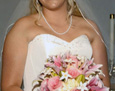 The bride carried a hand tied bouquet of Sorbonne lilies, light pink roses, stephanotis, and ivory stock.