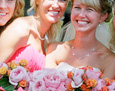 The bride carried David Austin roses. Her attendants carried orange spray roses and David Austin pink roses.