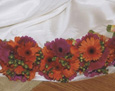 Her attendants carried hand-tied bouquets of bright pink and orange gerbera with green hypericum berries. Note the festive ribbon wrapping to finish the stems!