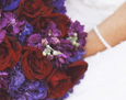Jewel-toned flowers with Black Magic roses, purple lisianthus, purple statice, and plum stock.