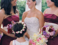 Her attendants carried hand-tied bouquets with white hydrangea, lavender stock, Black Magic roses, lavender roses, pink lisianthus, and pink hypericum berries.