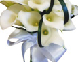 A hand-tied bouquet of mini calla lilies and lily grass, wrapped half of the way down with white satin ribbon.