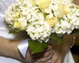 The bridal bouquet consisted of white stock and pale yellow roses with accents of stephanotis blossoms with pearl centers.