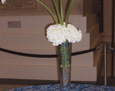 White callas pillowed with white hydrangea, then wired together to match the theme of the table linens.